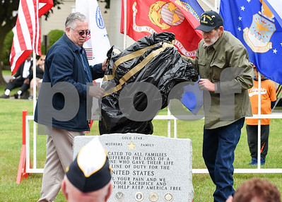 052917  Wesley Bunnell | Staff  Plainville held their annual Memorial Day Parade on Monday morning followed by a memorial unveiling dedicated to Gold Star Families at Veterans Memorial Park. Dan Burgess, L, lifts the cover along with Air Force veteran Bob Doolittle on the new monument. Bob Doolittle came up with the idea for the monument and proceeded with help from friend Dan Burgess.