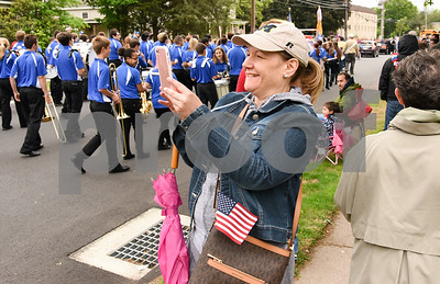 052917  Wesley Bunnell | Staff  Plainville held their annual Memorial Day Parade on Monday morning followed by a memorial unveiling dedicated to Gold Star Families at Veterans Memorial Park. A woman records video on her smart phone as the high school band marches past.