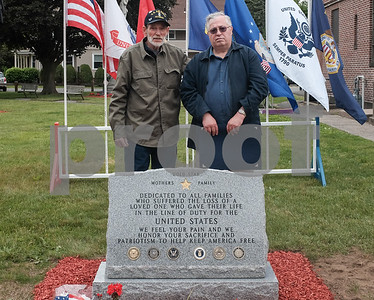 052917  Wesley Bunnell | Staff  Plainville held their annual Memorial Day Parade on Monday morning followed by a memorial unveiling dedicated to Gold Star Families at Veterans Memorial Park. Bob Doolittle & Dan Burgess stand with the monument at the conclusion of the ceremony. Bob came up with the idea for the memorial and proceeded with help from friend Dan.