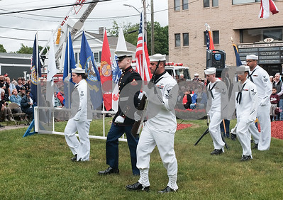 052917  Wesley Bunnell | Staff  Plainville held their annual Memorial Day Parade on Monday morning followed by a memorial unveiling dedicated to Gold Star Families at Veterans Memorial Park. The Navy & Marine Honor Guard march off at the end of the ceremony.