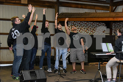 052517  Wesley Bunnell | Staff  The Berlin High School Upbeat Club held their annual picnic at the Berlin Fair Grounds on a soggy Thursday May 25. The Berlin Boys Choir performs in one of the many buildings.