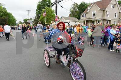 052917  Wesley Bunnell | Staff  Plainville held their annual Memorial Day Parade on Monday morning followed by a memorial unveiling dedicated to Gold Star Families at Veterans Memorial Park. A local resident rides his red white & blue themed bike near the end of the parade.