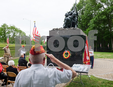 053017  Wesley Bunnell | Staff  Members from the Marine Corps League Hardware City Detachment were on hand to hold a Memorial Day ceremony at the Iwo Jima Memorial in Newington. Fred McGoldrick from the detachment salutes during the ceremony.