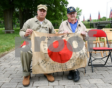 053017  Wesley Bunnell | Staff  Members from the Marine Corps League Hardware City Detachment were on hand to hold a Memorial Day ceremony at the Iwo Jima Memorial in Newington. President of the memorial park Mark A. Adamski, L, sits with Iwo Jima survivor Jim Cleary Jr. of Waterbury as they hold a flag captured during the battle on Mount Suribachi.