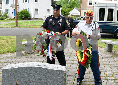 053017  Wesley Bunnell | Staff  A Memorial Day Ceremony was held at the Brian S. Letendre Memorial on Tuesday afternoon by the Marine Corps League Hardware City Detachment. New Britain Police Officer Peter Scirpo and Fred McGoldrick from the Marine Corps League lay wreaths at the memorial.