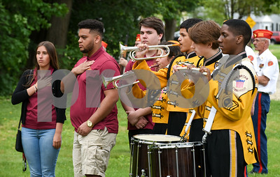 053017  Wesley Bunnell | Staff  A Memorial Day Ceremony was held at the Brian S. Letendre Memorial on Tuesday afternoon by the Marine Corps League Hardware City Detachment. Members from the New Britain High School Madrigal Singers and band stand as taps is played.