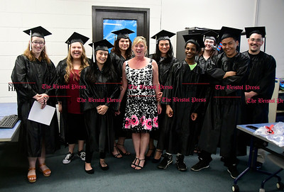5/18/2017 Mike Orazzi | Staff Jacquelyn Strawsonwith some of the graduates before Thursday night's Bristol Adult Education Graduation ceremony.