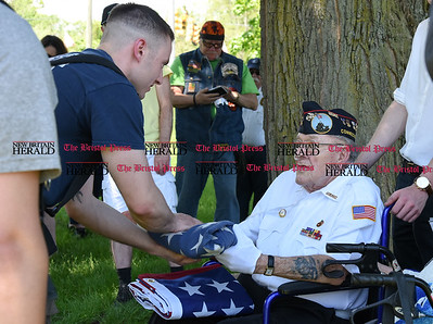 051817  Wesley Bunnell | Staff  95 year-old Iwo Jima Survivor George Caron receives a worn flag taken down from the Iwo Jima Memorial from Newington Firefighter Nick Giansanti before presenting Giansanti with a new flag to raise. George Caron along with his wife Lois purchased a custom made 48 star flag to replace the worn flag being used.
