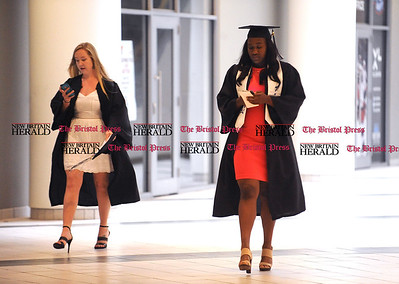 5/20/2017 Mike Orazzi   Staff Chayla Lewis (right) arrives at the the XL Center in Hartford for CCSU's graduation Saturday morning.