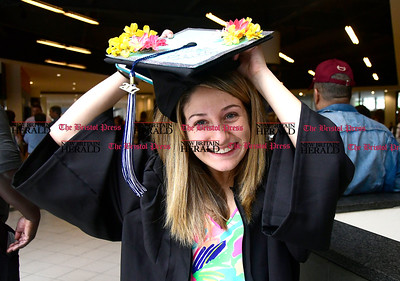 5/20/2017 Mike Orazzi | Staff Erica Pititto adjusts her cap the the XL Center in Hartford for CCSU's graduation Saturday morning.