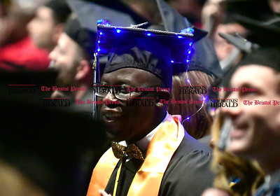 5/20/2017 Mike Orazzi | Staff Joshua Fritho with some blue LED lights on his cap at the the XL Center in Hartford for CCSU's graduation Saturday morning.