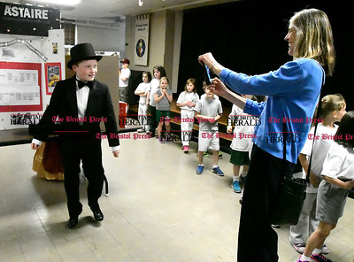 5/2/2017 Mike Orazzi | Staff Anna  Kronen photographs St. Joseph School 5th grade student Christian Roche as Fred Astaire during the school's annual wax museum Tuesday afternoon.