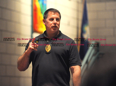 5/23/2017 Mike Orazzi | Staff Bristol Police Detective Mike Brasche gives a presentation to Chippens Hill Middle School students about illegal drug use Tuesday.
