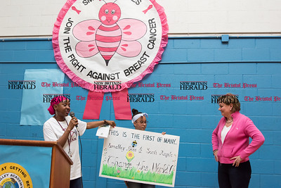 052617  Wesley Bunnell | Staff  Smalley Academy presented the CT Breast Health Initiative with a check for over $2,000 through various fund raising activities.  Smalley Say No to Breast Cancer committee member Paula Richardson makes introductions as a Smalley student presents CT Breast Health Initiative Presdient Joyce Bray with a ceremonial check.