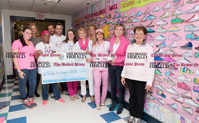 052617  Wesley Bunnell | Staff  Smalley Academy presented the CT Breast Health Initiative with a check for over $2,000 through various fund raising activities. Smalley Academy Say No to Breast Cancer committee members pose with CT Breast Health Initiative President Joyce Bray, second from the right.