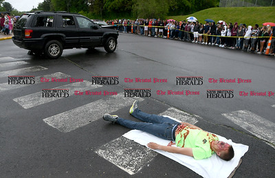 5/26/2017 Mike Orazzi | Staff Bristol Central High School student Simon Andrews during a mock crash staged Friday morning.