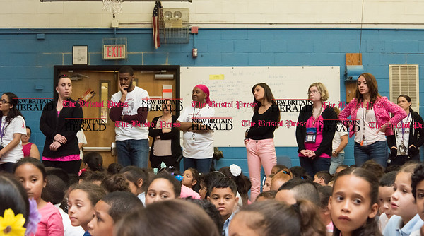 052617  Wesley Bunnell | Staff  Smalley Academy presented the CT Breast Health Initiative with a check for over $2,000 through various fund raising activities. Teachers, some overcome with emotion, stand next to students during the presentation.