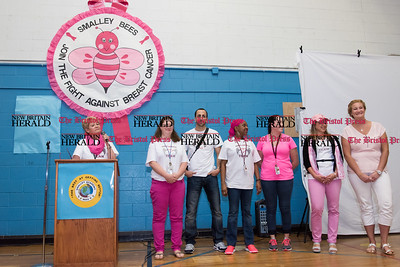 052617  Wesley Bunnell | Staff  Smalley Academy presented the CT Breast Health Initiative with a check for over $2,000 through various fund raising activities. Principal Saavedra speaks at the podium next to the Smalley Academy Say No to Breast Cancer committee members. Members include Sorangel Junquera, Paula Richardson, Theresa Gouveia, Kathi Ulatowski, Franco Cartiera, Heather O'Bright.