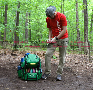 5/27/2017 Mike Orazzi | Staff Ian Schulman keeps track of the score  while playing a disk golf fundraiser for Kevin Adorno in Page Park Saturday morning.
