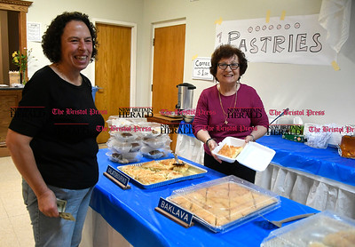 5/27/2017 Mike Orazzi | Staff Sue Egan buys some pastries from Eva Kokis during the Saint George Greek Orthodox Church Dionysos Greek Festival Saturday in New Britain.