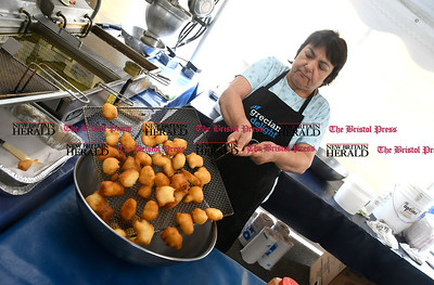 5/27/2017 Mike Orazzi | Staff Andrea Varvatsis prepares loukoumades during the Saint George Greek Orthodox Church Dionysos Greek Festival Saturday in New Britain.