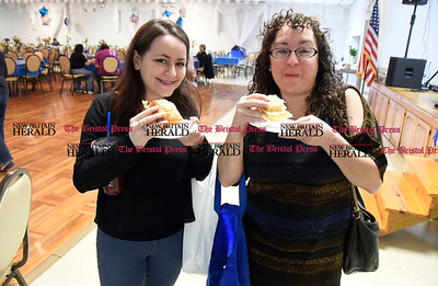 5/27/2017 Mike Orazzi | Staff Calliana Faulk and her mom Kathy Puffe enjoy Greek cheese bread during the Saint George Greek Orthodox Church Dionysos Greek Festival Saturday in New Britain.