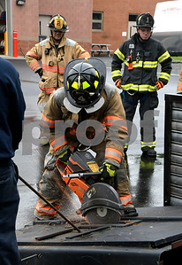 5/31/2017 Mike Orazzi | Staff Bristol firefighter Dominic Decarlo while doing forced entry training at Engine 4 Wednesday morning.