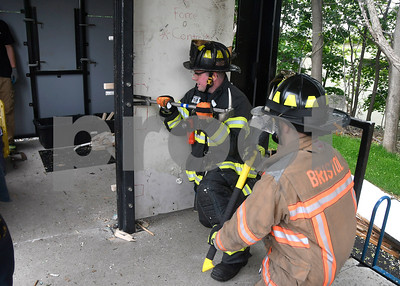 5/31/2017 Mike Orazzi | Staff Bristol firefighter Alan Rudolewicz and  Dominic Decarlo while doing forced entry training at Engine 4 Wednesday morning.