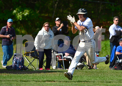 5/31/2017 Mike Orazzi | Staff St. Paul's Thomas Houle (5)  celebrates as he crosses the plate during the Class S Second Round Baseball game with Immaculate in Bristol Wednesday.