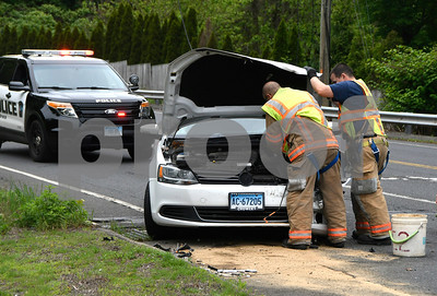 5/31/2017 Mike Orazzi | Staff Bristol firefighters on scene of a two car crash at the intersection of Wolcott Road and Wolcott Street. The Volkswagen was towed and the Saturn was able to be driven from the scene. No injuries were reported.