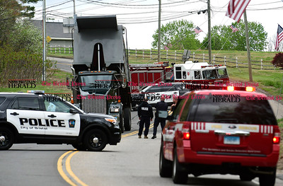 5/3/2017 Mike Orazzi | Staff A closed Route 6 after a dump truck snapped a utility pole on Terryville Road causing a loss of power to parts of downtown Wednesday afternoon.
