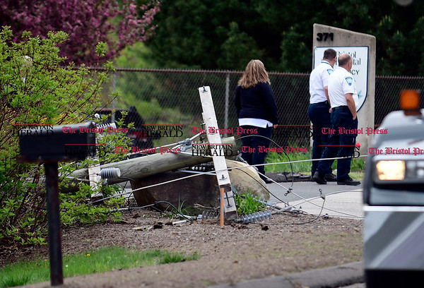 5/3/2017 Mike Orazzi | Staff A snapped utility pole after a dump truck with a raised bed snagged wires on Terryville Road causing a loss of power to parts of downtown Bristol Wednesday afternoon.