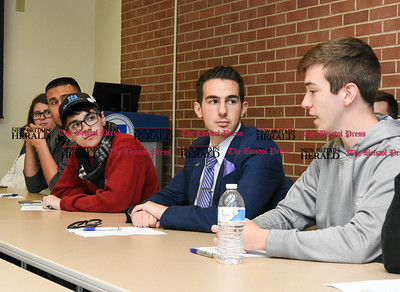 050517  Wesley Bunnell | Staff  Congresswoman Elizabeth Esty spoke with CCSU student leaders on an Immigration Roundtable on Friday afternoon. Students Akai Long & Chris Marinelli listen as Christopher Theriault voices his concerns.