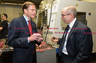 050517  Wesley Bunnell | Staff  Senator Richard Blumenthal stands with President of Winslow Automatics Incorporated J. George Podlasek as they hold parts manufactured for use in the engine of the F-35 fighter. The senator visited Winslow Automatics Incorporated on Friday afternoon for a discussion on small businesses.