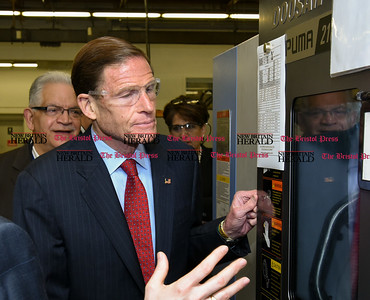 050517  Wesley Bunnell | Staff  Senator Richard Blumenthal peeks inside of a milling machine used to manufacture parts at Winslow Automatics Incorporated for use on the F-35 fighter on Friday afternoon during a discussion on small businesses. SBA Senior Area Manager Frank Alvarado stands behind the senator.