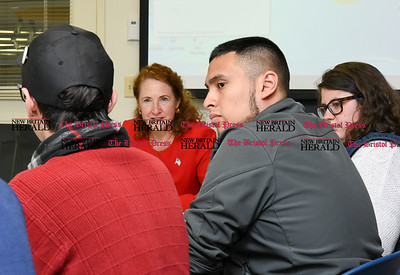 050517  Wesley Bunnell | Staff  Congresswoman Elizabeth Esty spoke with CCSU student leaders on an Immigration Roundtable on Friday afternoon. Congresswoman Esty listens to student Akai Long voice his concerns as fellow student Victor Constanza looks on.