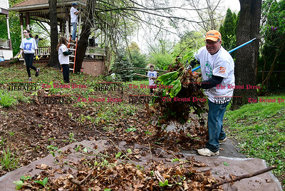 5/6/2017 Mike Orazzi | Staff Paul Griswold cleans up during Saturday's HomeFront Day on Grove Hill Street in Berlin.
