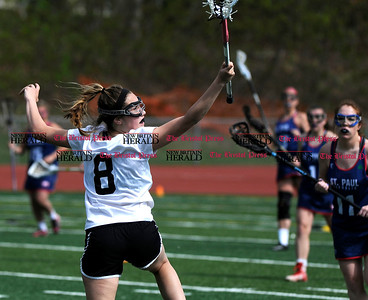 5/6/2017 Mike Orazzi | Staff Bristol Coop Girls Lacrosse Gabriele Abramczyk (8)during lacrosse with  St. Paul Catholic High School Saturday at Bristol Eastern.