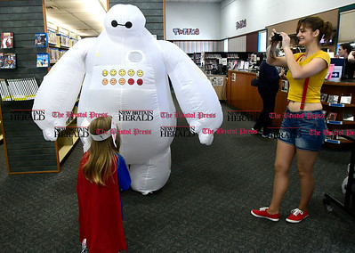 5/6/2017 Mike Orazzi | Staff Anne Ditieri photographs Elise Hayden as she greets Bernie Berube during the Southington Public Library's ComicCon Saturday.