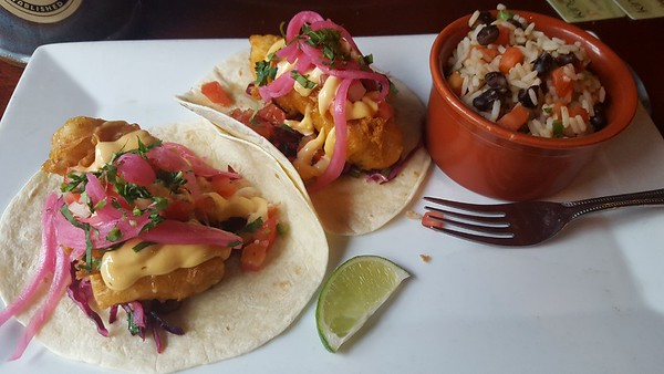 Deb Armstrong - Dining out at Iron Hill Brewery and having Baja Style Fish Tacos with red cabbage slaw