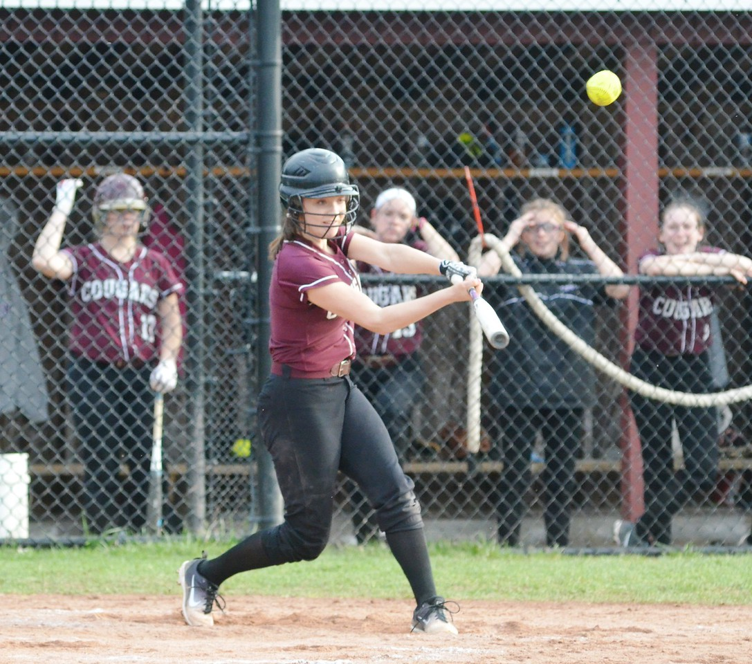 John Brewer - Oneida Daily Dispatch Stockbridge Valley's Jillian Jacobs connects for an RBI triple during the second game of a double-header against DeRuyter in an 11-2 Cougar win.