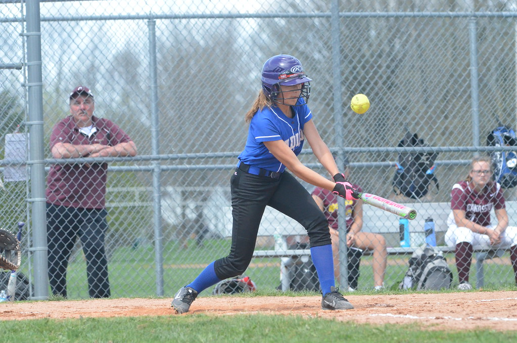 . John Brewer - Oneida Daily Dispatch Madison�s Halle Hauck slaps a Hayley Patane offering during the first of two games played in Canastota.