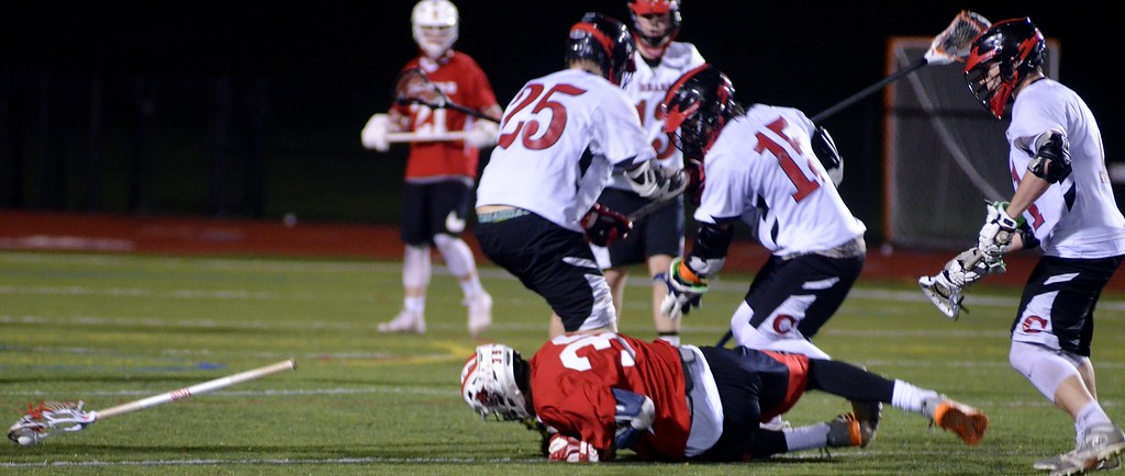 . Andrew Aurigema - Oneida Daily Dispatch A handful of Chittenango players look to pick up a loose ball in their 9-7 victory over Vernon-Verona-Sherrill Thursday, May 3, 2018.