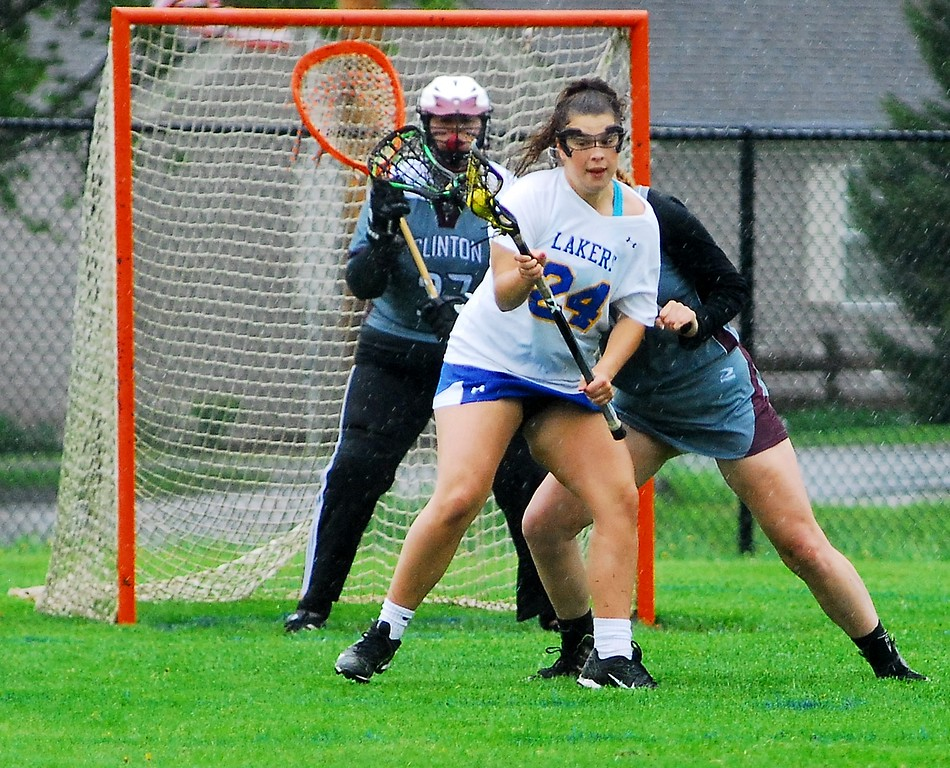 . Andrew Aurigema - Oneida Daily Dispatch Cazenovia senior attacker Chloe Willard makes a move on Clinton junior defender Olivia Wightman Saturday, May 19 at Cazenovia.