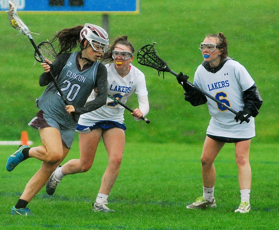 . Andrew Aurigema - Oneida Daily Dispatch Clinton sophomore midfielder Wiley Gifford is defended by Cazenovia sophomore midfielder Laura Connor (right) and sophomore midfielder Ava Hartley (left) Saturday, May 19 at Cazenovia.