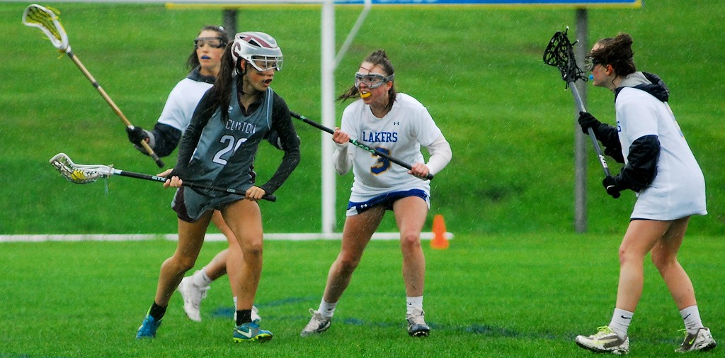 . Andrew Aurigema - Oneida Daily Dispatch Clinton sophomore midfielder Wiley Gifford is defended by Cazenovia sophomore midfielder Laura Connor (right) and sophomore midfielder Ava Hartley (left) Saturday, May 19.