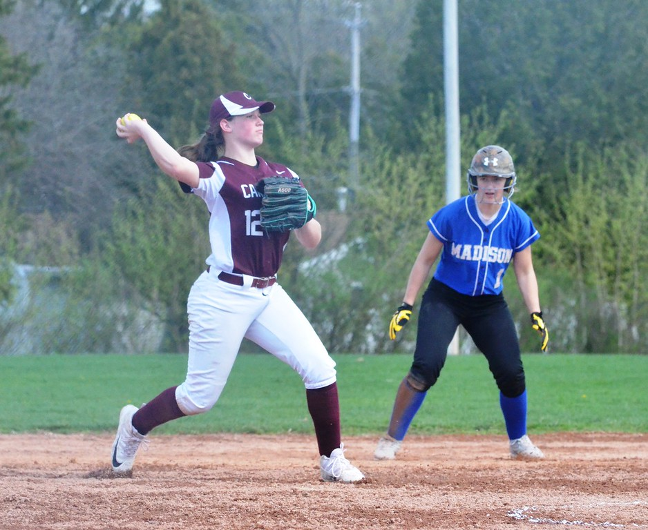 . John Brewer - Oneida Daily Dispatch Canastota third baseman Jessica Evans throws to first after fielding a grounder.
