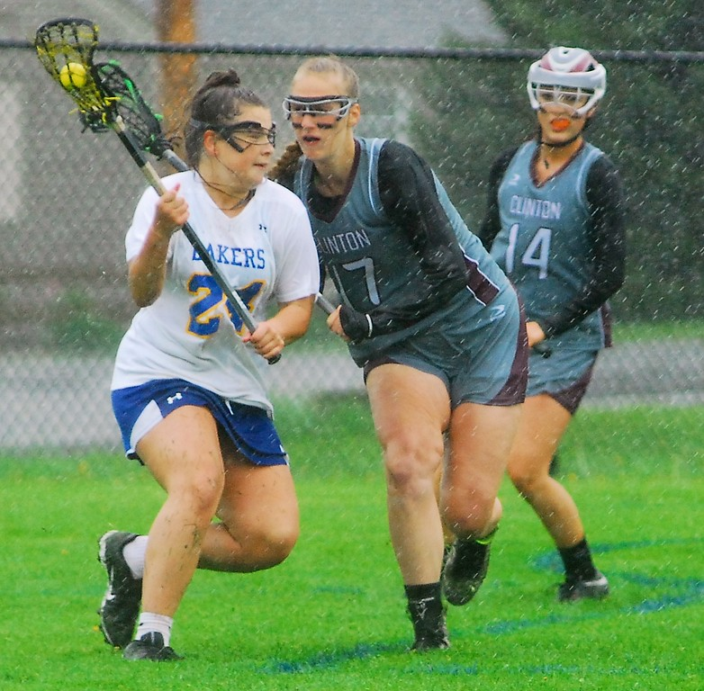 . Andrew Aurigema - Oneida Daily Dispatch Cazenovia senior attacker Chloe Willard makes a move on Clinton junior defender Olivia Wightman Saturday, May 19.