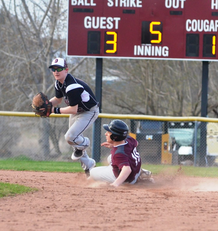 . John Brewer - Oneida Daily Dispatch DeRuyter�s Ryan Wood lays a tag on Stockbridge Valley�s Chad Masker during the first game of a doubleheader on Tuesday, May 1.