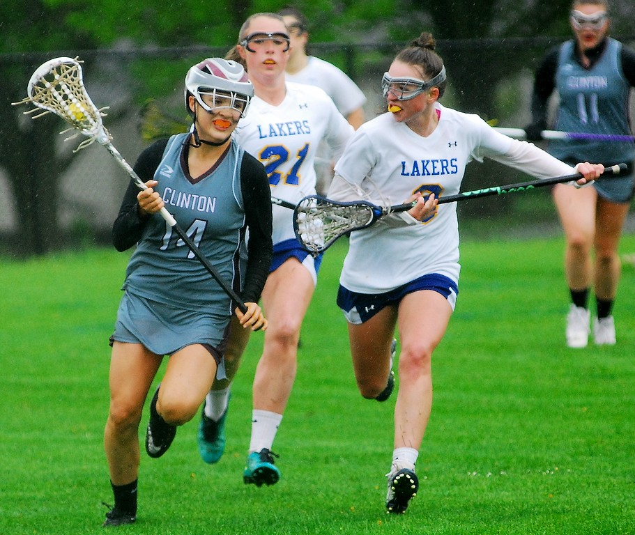 . Clinton defender Lexi Emery takes the ball up to midfield while being chased by Cazenovia sophomore midfielder Ava Hartley (right) and Cazenovia senior attacker Mikaylee Whalen (middle) Saturday, May 19 at Cazenovia.